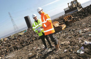 Stock image of an Environment Agency officer working with a contractor at a waste site