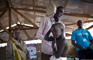 A child is weighed as part of a nutritional assessment in Unity State, South Sudan, December 2016. Picture: UNICEF/Kate Holt
