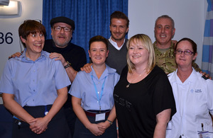 Ray Winstone and David Beckham with staff and patients at the Queen Elizabeth Hospital Birmingham [Picture: via MOD]