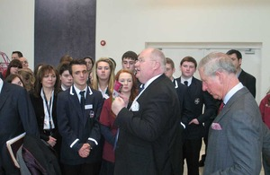 Eric Pickles and the Prince of Wales with a group of young people.