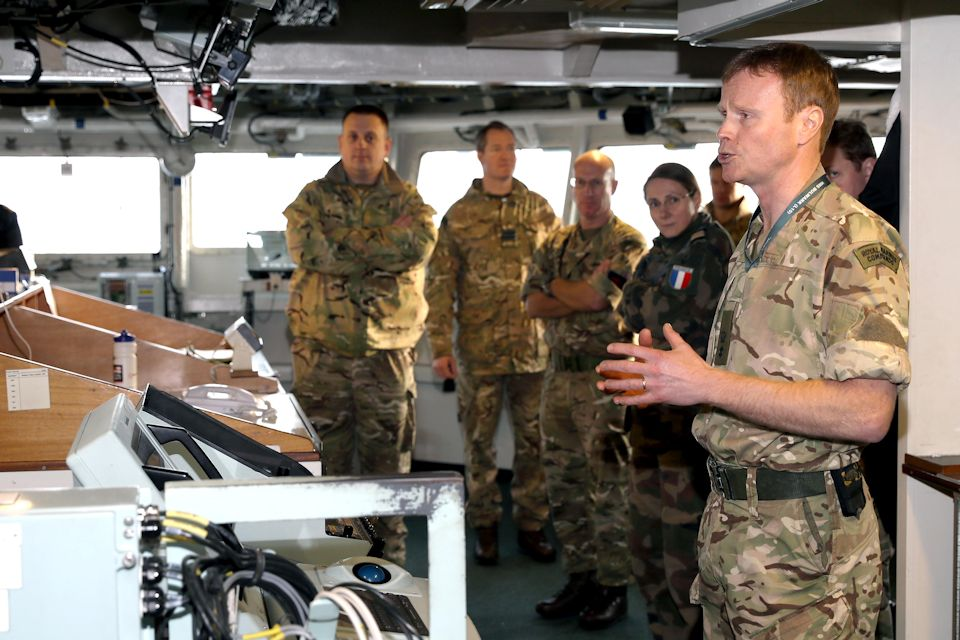 Lt Col James Fuller, RM, briefs SJFHQ personnel on the capabilities of HMS Bulwark. Crown Copyright/MOD 2017. All rights reserved