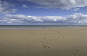 Flat beach, shoreline and cloudscape
