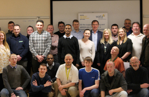 The group of trainees with trainers and employers at the end of the pilot programme