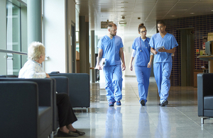 Junior doctors walking down a hospital corridor