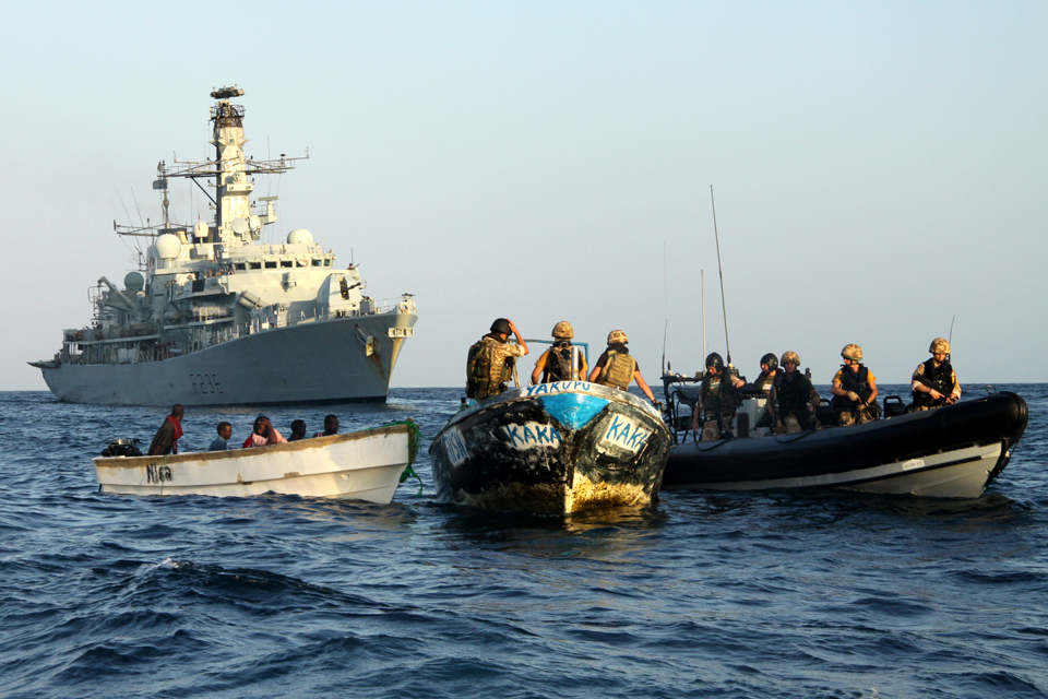 A boarding team from HMS Montrose confiscates suspected pirates' gear