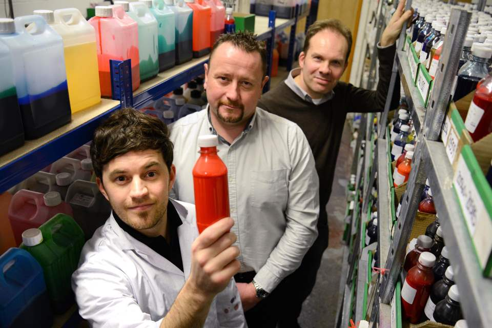 KTP partners in the paint store room with products on shelves