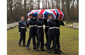 Members of the RAF Queen's Colour Sqn Bear Sgt Lawson's coffin. Crown Copyright. All rights reserved