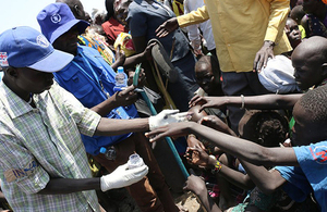 Children reach to have their fingers dipped in ink as part of a WFP/FAO food distribution supported by UK aid in Leer County, South Sudan. Picture: George Fominyen
