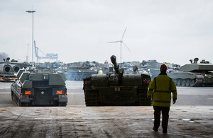 A Challenger 2 tank and other armoured vehicles from 20 Armoured Infantry Brigade being loaded onto cargo ship, before being transported to Estonia.