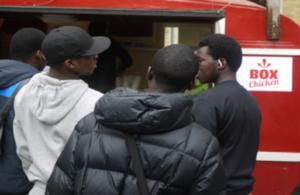Photo of children buying food at Box Chicken van
