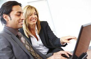 Female businesswoman mentors young male entrepreneur