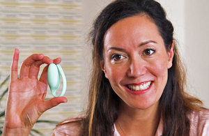 Tania Boler holding the company's pelvic floor exercise tracker.