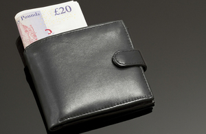 Wallet showing £20 banknotes