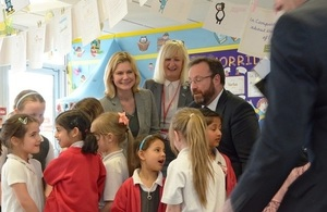 Justine Greening surrounded by primary schoolchildren