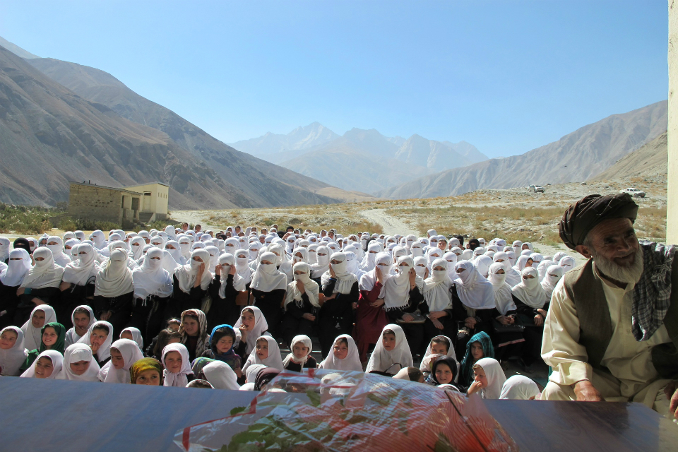 Afghan school girls benefiting from the school building