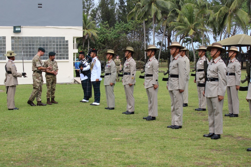 His Majesty inspecting the Honour Guard accompanied by The Commander, British Forces Brunei, Lieutenant Colonel Charlie Crowe