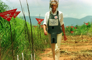 Diana, Princess of Wales, walks in one of the safety corridors of the landmine fields of Huambo, Angola, during a visit to the country in 1997.