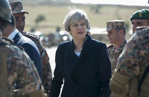 Prime Minister Theresa May visiting armed forces in Jordan.