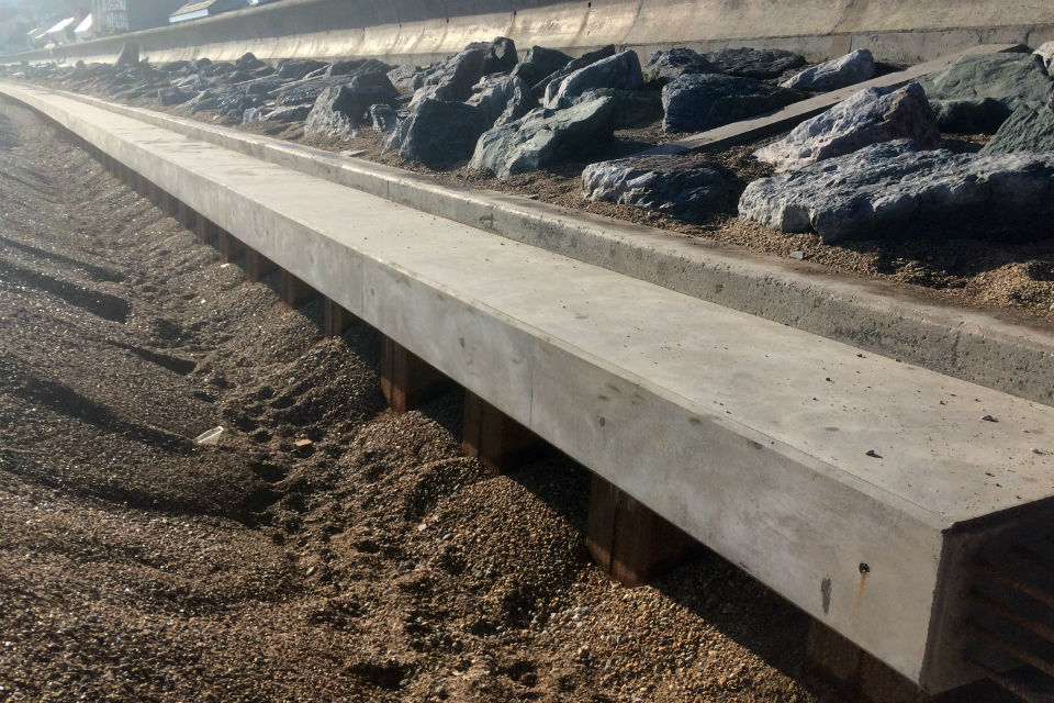 A long concrete beam sat atop a rows of pile