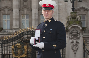 Marine Mark Williams with his Military Cross at Buckingham Palace [Picture: Sergeant Adrian Harlen, Crown Copyright/MOD 2013]