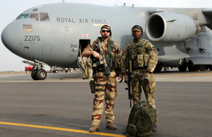 Senior Aircraftman William Wambiru (right) stands guard with a member of the French Air Force at Bamako Airport in Mali [Picture: Wing Commander Dylan Eklund, Crown Copyright/MOD 2013]