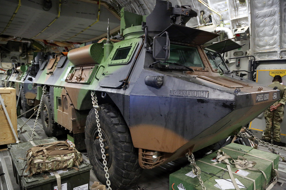 Three French Army armoured personnel carriers on board a Royal Air Force C-17 aircraft bound for Mali