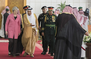 The Prime Minister walking with King Salman