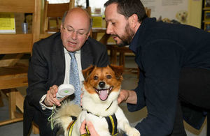 Lord Gardiner checks the microchip of Messi the dog