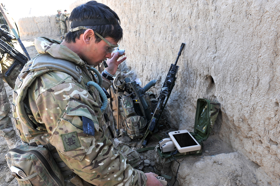 Sergeant Scott Weaver launches a Black Hornet Nano Unmanned Air Vehicle from a compound in Afghanistan