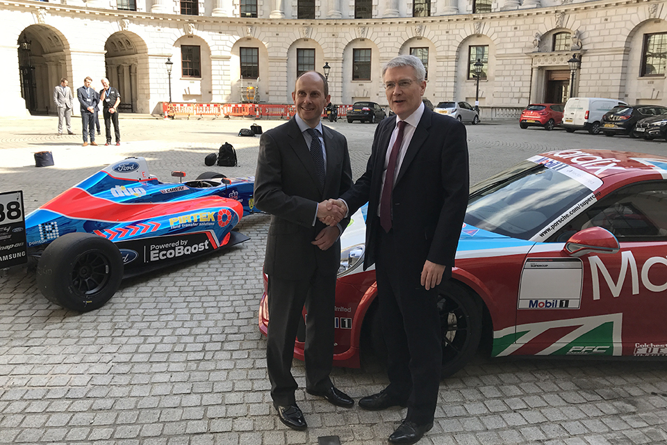 Roads Minister Andrew Jones and Ben Taylor, Managing Director, International Motor Sports, with a Porsche 911 GT3 Cup race car and a Mygale-Ford Formula 4 car.
