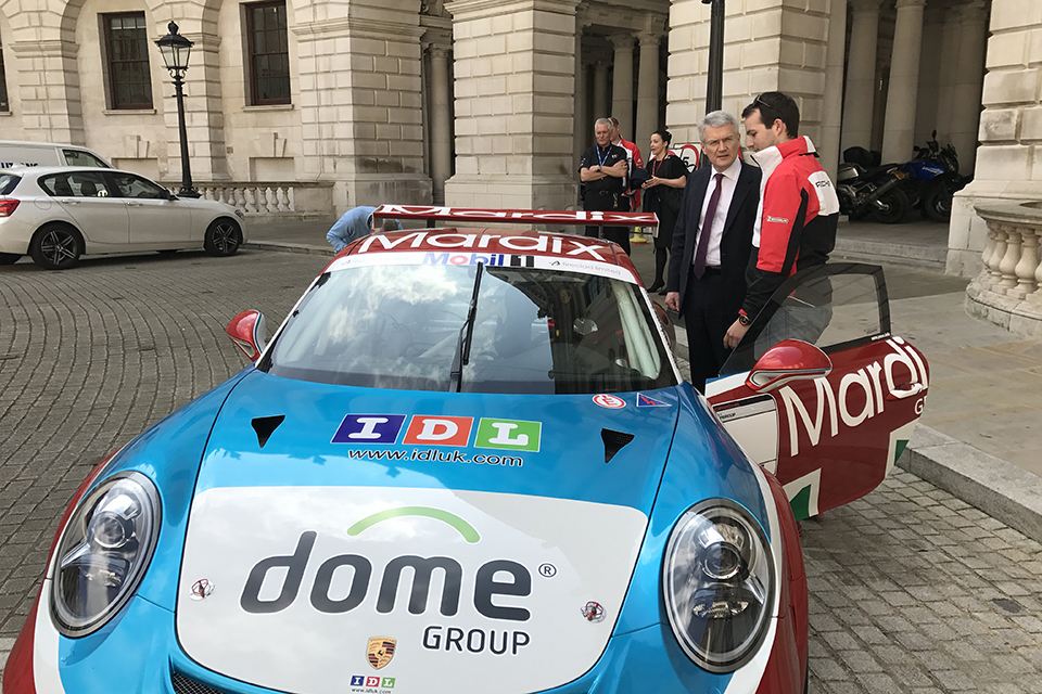 Roads Minister Andrew Jones with  Porsche driver Tom Sharp.