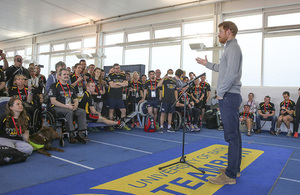 Prince Harry addresses some of the UK Team at the University of Bath Sports Training Village