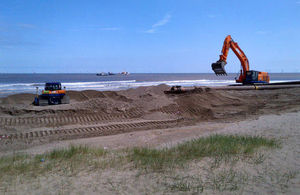 Sand is dredged from the seabed to replace beach levels lost to the sea over the winter