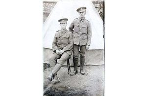 Pte Reuben Kimberley seated with comrade, Crown Copyright, All rights reserved