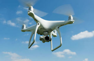 Quadcopter drone flying in the sky