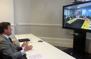 International Trade Minister Greg Hands, accompanied by Peruvian Ambassador to the UK Claudio de la Puente Ribeyro, signs the arrangement via video-link with the Lima 2019 organising committee.