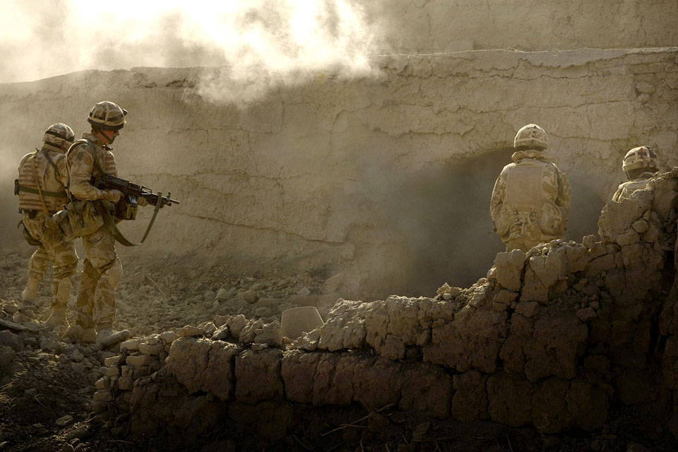 Royal Marines conducting a deliberate action against Taliban insurgents in Afghanistan