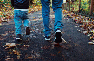 Child and parent walking.