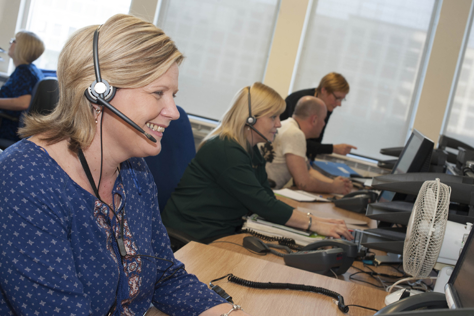 Ladies wearing headsets on the helpdesk