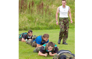 Corporal Neil Owen puts some of the Nottingham rugby players through their paces [Picture: Ian Forshaw, Crown Copyright/MOD 2010]