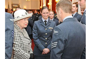 Her Majesty The Queen talking to Flight Lieutenant Shasha Sheard and Sergeant Mick Goddard at RAF Marham [Picture: Corporal Trish Morrison, Crown Copyright/MOD 2012]