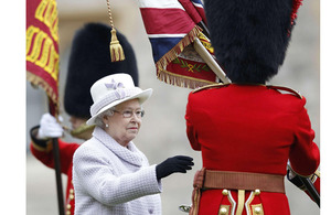 Her Majesty The Queen presents new Colours to the Coldstream Guards at Windsor Castle [Picture: Andrew Winning/PA Wire 2012]