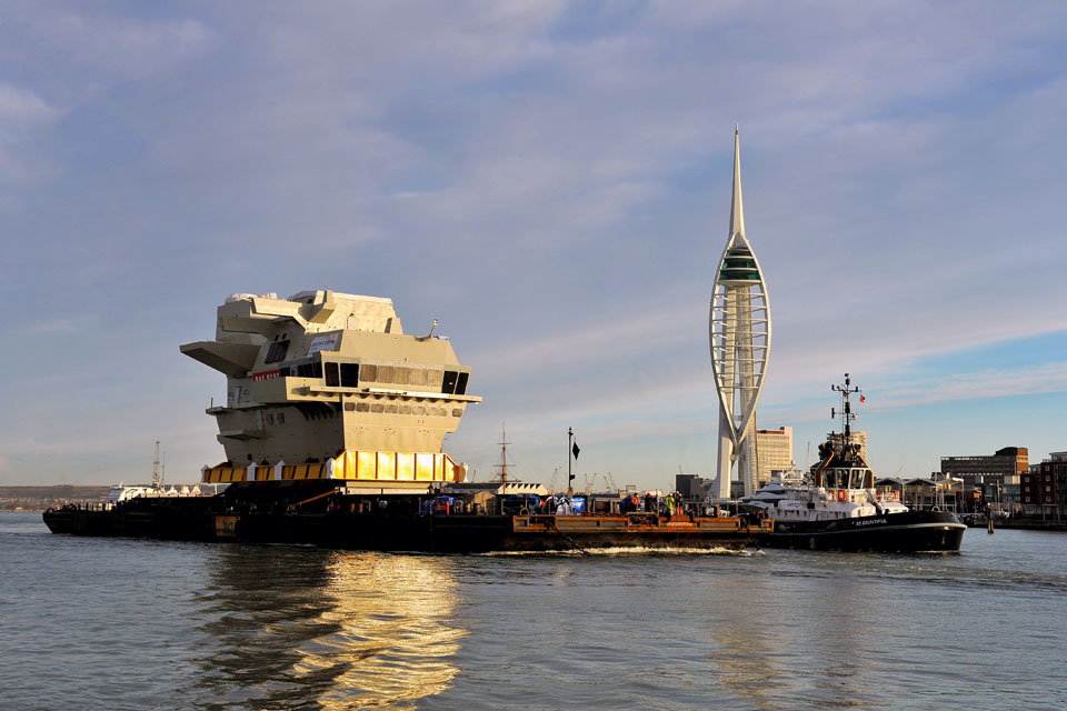 The forward island section of HMS Queen Elizabeth leaves Portsmouth Naval Base
