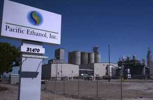 Long-distance picture of Pacific Ethanol plant with company signage in foreground