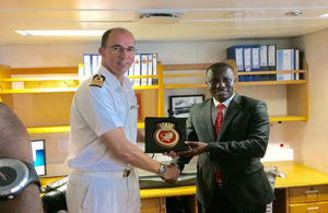 Minister for Defence and Captain of HMS Protector