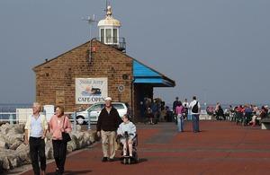 People at Morecambe Bay, Lancashire.