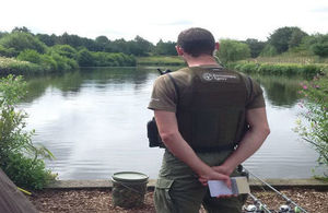 Fisheries enforcement officer checking licences