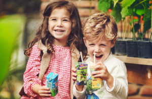 Children drinking Appy Food and Drinks products