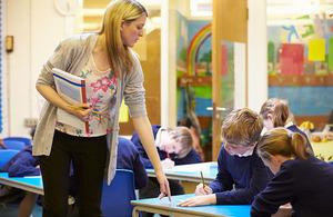 teacher watching over pupils