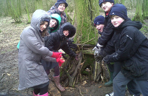 Schoolchildren helping with tree-planting in Essex [Picture: Crown Copyright/MOD 2013]